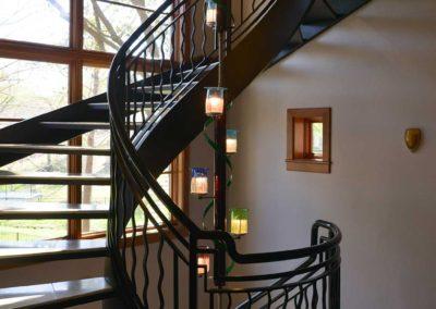 Spans 3 stories through spiral staircase