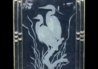 Sand carved egrets in private residence